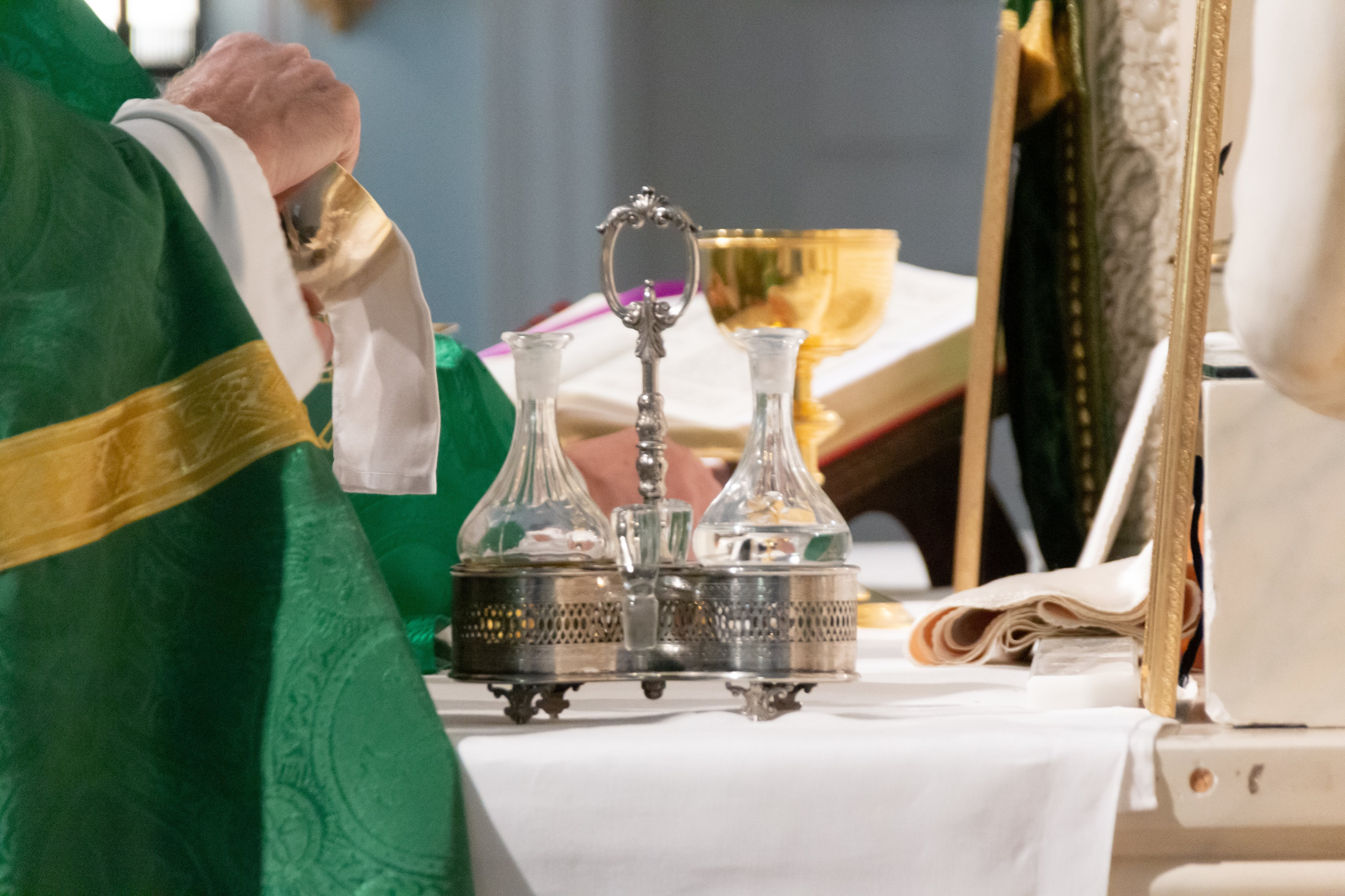 priest green altar homily.jpg